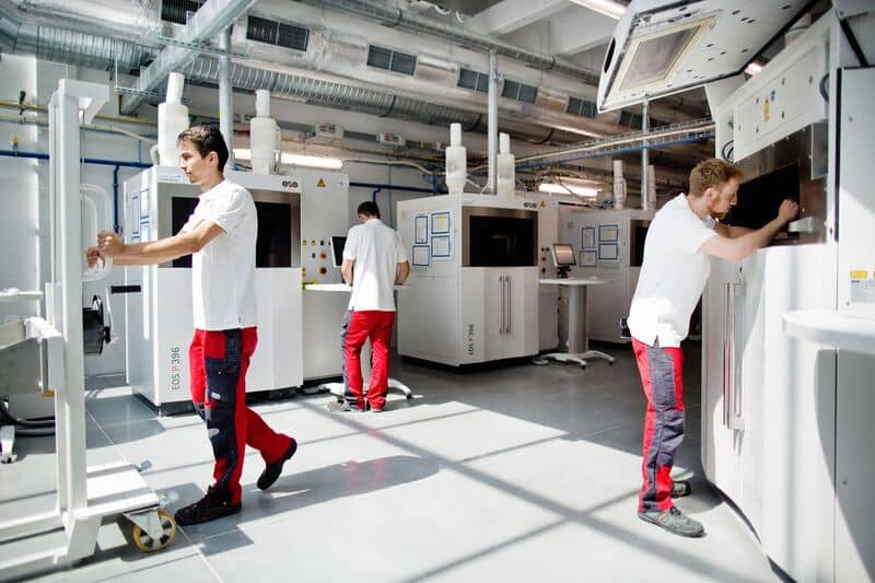 Materialise employees ar 3D printing laser sintering production floor
