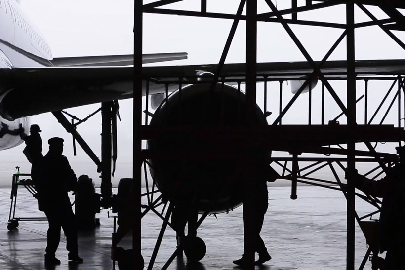 Technical staff doing maintenance for aircraft in a hangar