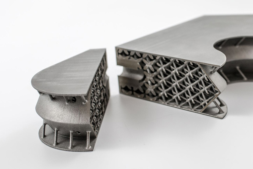 The cross-section of a 3D printed titanium satellite inserts showing the lightweight structures within