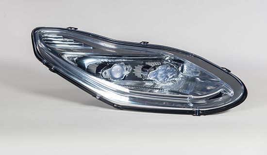 Headlight Prototype. Printed in TuskXC2700T, ABS & Polyamide using Stereolithography (SLA), Fused Deposition Modelling (FDM) & Selective Laser Sintering (SLS) with cosmetic transparent & chrome sputtering finishes