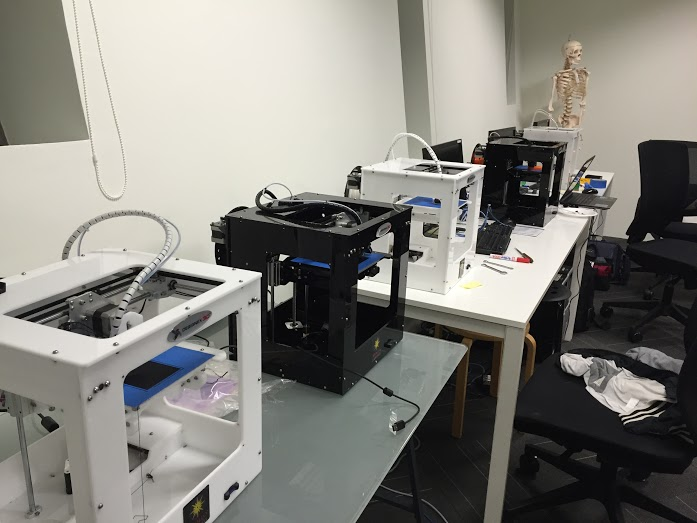 All five 3D printers running non-stop, printing design prototypes
