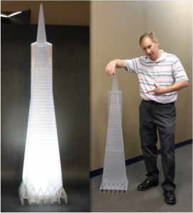 Todd Reese pictured with the scale model of the Transamerica Pyramid